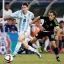 Argentina's Lionel Messi controls the ball past Mexico's Andres Guardado during a friendly soccer match at the AT&T Stadium in Arlington, Texas, Tuesday, Sept. 8, 2015. The match ended in a 2-2 tie. (AP Photo/Tony Gutierrez)