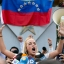 Lilian Tintori, wife of jailed opposition leader Leopoldo Lopez, speaks to her husband supporters, in Caracas, Venezuela, Friday, Sept. 11, 2015. Lopez was convicted late Thursday of inciting violence during a wave of protests against the South American country's socialist administration in 2014, and was sentenced to the maximum punishment of nearly 14 years in military prison. (AP Photo/Ariana Cubillos)
