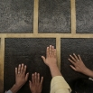 Muslim pilgrims pray while touching the Kaaba, the cubic building at the Grand Mosque in the Muslim holy city of Mecca, while performing Tawaf, an anti-clockwise movement around the Kaaba and one of the main rites of the annual pilgrimage, known as hajj, in Saudi Arabia on Monday, Sept. 21, 2015. (AP Photo/Mosa'ab Elshamy)