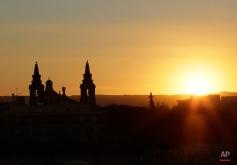 The sun sets in the city of Valletta, Malta, Tuesday Nov. 10, 2015. (AP Photo/Antonio Calanni)
