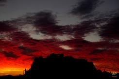 Red clouds are seen over the ancient Acropolis hill as the sun sets in the city of Athens, Tuesday, Nov. 3, 2015. (AP Photo/Petros Giannakouris)