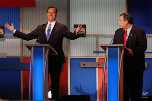 Rick Santorum gestures as Chris Christie watches during Republican presidential debate at Milwaukee Theatre, Tuesday, Nov. 10, 2015, in Milwaukee. (AP Photo/Jeffrey Phelps)