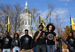 Jonathan Butler, center, addresses a crowd following the announcement that University of Missouri System President Tim Wolfe would resign Monday, Nov. 9, 2015, at the university in Columbia, Mo. Butler has ended his hunger strike as a result of the resignation. (AP Photo/Jeff Roberson)