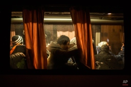 Migrants sit in a bus on their arrival from Preshevo to the train station in Sid, Serbia Thursday, Nov. 5, 2015, near the Croatian border, where Serbian authorities load migrants on a train to send them to Croatia. (AP Photo/Manu Brabo)