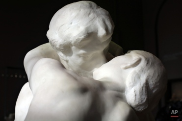 """The sculpture """"Le Baiser"""" (The Kiss) by French sculptor Auguste Rodin (1840-1917) is displayed at the Rodin museum in Paris, France, Thursday, Nov. 5, 2015. Paris' historic Rodin Museum, until recently plagued by a leaking roof, peeling gold leaf and creaky floorboards, has been returned to its former splendor following a 16 million euro ($17.4 million) three-year restoration. The museum reopens to the public Nov. 12. (AP Photo/Thibault Camus)"""