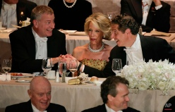 In response to comments made by guest speaker former New York Mayer Michael Bloomberg, New York Mayor Bill de Blasio, left, shakes hands with New York Gov. Andrew Cuomo, right, as Nan Smith, center, looks on, during the Alfred E. Smith Memorial Foundation dinner, Tuesday, Nov. 10, 2015, in New York. (AP Photo/Julie Jacobson)