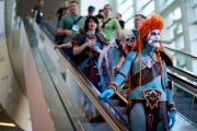 """A woman dressed as Voljin from the video game World of Warcraft rides an escalator at the BlizzCon, Friday, Nov. 6, 2015, in Anaheim, Calif. """"World of Warcraft"""" maker Blizzard is hosting its ninth annual fan-centric convention opening Friday. (AP Photo/Jae C. Hong)"""