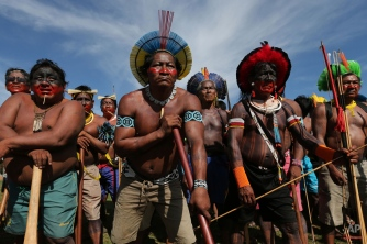 Native Brazilians perform a ritual dance during a protest against a proposed constitutional amendment that would put the demarcation of indigenous lands into the hands of the Congress, in front of the Brazilís National Congress, in Brasilia, Brazil, Tuesday, Nov. 10, 2015. A lower house commission has approved the proposal but it must make its way through the Senate, and be signed by President Dilma Rousseff to become law. (AP Photo/Eraldo Peres)