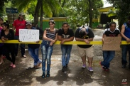"""Cuban migrants hold a sign that reads in Spanish """"Ortega Nazi"""" in reference to Nicaragua's President Daniel Ortega while another migrant holds one that reads """"Liberty for a Cuban migrants"""" at the Costa Rican border with Nicaragua, in Penas Blancas, Monday, Nov. 16, 2015. More than 1 thousand Cuban migrants heading north to the United States tried to cross the border from Costa Rica into Nicaragua, causing tensions to soar between the neighbors as Nicaraguan security forces sought to turn them back. Following the thaw in relations between Washington and Havana, some Cubans have been making their way to Central America in hopes of then heading through Mexico and into the United States. (AP Photo/Esteban Felix)"""