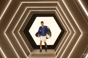 Novak Djokovic of Serbia arrives to play his quarterfinal match with Tomas Berdych of Czech Republic at the BNP Masters tennis tournament, at Bercy Arena, in Paris, France, Friday, Nov. 6, 2015. (AP Photo/Francois Mori)