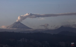 The Cotopaxi volcano spewing ash and vapor, is seen from Quito, Ecuador, Monday, Nov. 16, 2015. The Cotopaxi began showing renewed activity in April and its last major eruption was in 1877. (AP Photo/Dolores Ochoa)