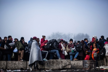 Migrants gather to gain entrance to Austria, at the Slovenian Austrian border, in Sentilj, Slovenia, Tuesday, Nov. 3, 2015. Slovenia has said its ability to deal with the influx has been stretched to the limit with thousands of migrants crossing its territory in hopes of reaching Western Europe. (AP Photo/Manu Brabo)