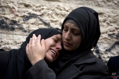 Palestinian women cry after taking the last look at the bodies of Ahmed Abu al-Aish, 28, and Laith Manasrah, 21, during their funeral, in the Qalandia refugee camp on the outskirts of the West Bank city of Ramallah, Monday, Nov. 16, 2015. Two Palestinians were killed and three wounded in clashes with Israeli troops early Monday in a Palestinian refugee camp in the Jerusalem area, a Palestinian health official said. The Israeli military said its troops entered Qalandia to demolish the home of a Palestinian who it says shot and killed an Israeli motorist in the West Bank this summer after he stopped to give the Palestinian directions to a nearby spring. (AP Photo/Majdi Mohammed)