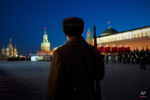 Russian soldiers dressed in Red Army World War II uniform attend a rehearsal for the Nov. 7 parade in the Red Square with St. Basil Cathedral, left, and Spassky Tower and the Kremlin in the background, in Moscow, Russia, Friday, Nov. 06, 2015. The parade marks the 74th anniversary of a Nov. 7 parade on Red Square when soldiers went directly to the front during World War II. For decades Nov. 7 was a holiday celebrating the 1917 Bolshevik Revolution. (AP Photo/Ivan Sekretarev)