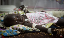 Nyalou Thong, 13 months old and one of only two people who survived Wednesday's cargo plane crash, lies in a hospital bed in Juba, South Sudan Thursday, Nov. 5, 2015. A thirteen-month-old baby and a man who was found cradling the infant were the only survivors of a cargo plane that crashed soon after taking off from a South Sudan airport, killing 37 people, a witness and relatives said Thursday. (AP Photo/Jason Patinkin)
