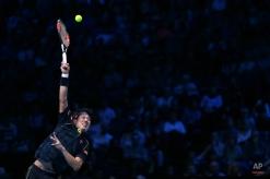 Japan's Kei Nishikori serves to the Czech Republic's Tomas Berdych during their ATP World Tour Finals tennis match at the O2 Arena in London, England, Tuesday Nov. 17, 2015. (AP Photo/Tim Ireland)