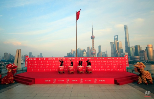 From left to right, golf players Henrik Stenson, Rickie Fowler, Jordan Spieth and Bubba Watson, drum during the HSBC Champions golf tournament photocall in Shanghai, China Tuesday, Nov. 3, 2015. (AP Photo)