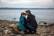 A Syrian man kisses his daughter shortly after disembarking from a dinghy at a beach on the Greek island of Lesbos after crossing the Aegean sea from the Turkish coast, Monday, Nov. 16, 2015. Greek authorities say 1,244 refugees and economic migrants have been rescued from frail craft in danger over the past three days in the Aegean Sea, as thousands continue to arrive on the Greek islands. (AP Photo/Santi Palacios)