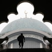 A Malaysian Muslim man is silhouetted against the Wilayah Mosque shrouded with haze in Kuala Lumpur, Malaysia, Monday, Oct. 19, 2015. Malaysian authorities ordered school closure again due to the haze situation. (AP Photo/Joshua Paul)