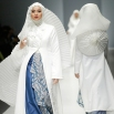 Models display creations by Irna Laperle during the Jakarta Fashion Week 2016 in Jakarta, Indonesia, Monday, Oct. 26, 2015. (AP Photo/Achmad Ibrahim)