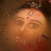 An idol of Hindu goddess Durga floats in water as devotees immerse the same in the River Kuakhai after the Durga Puja festival in Bhubaneswar, India, Saturday, Oct. 24, 2015. The immersion of idols marks the end of the festival that commemorates the slaying of a demon king by lion-riding, 10-armed goddess Durga, marking the triumph of good over evil. (AP Photo/Biswaranjan Rout)