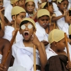 A boy dressed as India's independence leader Mahatma Gandhi yawns as he participates with others in an attempt to create a Guinness record, during celebrations to mark Gandhi's birth anniversary in Bangalore, India, Friday, Oct. 2, 2015. 4605 children participated in the event to break the record of largest gathering of people dressed as Gandhi, according to organizers. (AP Photo/Aijaz Rahi)