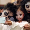 Filipino children, from left, Gabriele Ryan Cortez, Andrea Nicole Baclagan and Chloe Denise Idpan pose for a selfie during a Halloween event in Manila, Philippines on Sunday, Oct. 25, 2015. (AP Photo/Aaron Favila)