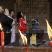 A family pays respect to their ancestors at a private columbaria on the Double Ninth Festival or Chung Yeung Festival, in Hong Kong, Wednesday, Oct. 21, 2015. The Double Ninth Festival, observed on the ninth day of the ninth month in the Chinese lunar calendar, is a day to respect and remember ancestors. The ritual is widely followed in Hong Kong among people in the Chinese community. (AP Photo/Vincent Yu)