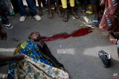 A protester lays dead after being shot in the Kinama district of Bujumbura, Burundi, Thursday May 7, 2015. (AP Photo/Jerome Delay)