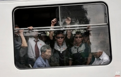 Commuters ride on a city trolley bus, Friday, Sept. 11, 2015 in Pyongyang, North Korea. The city trolley is one of the more common forms of public transportation among North Koreans living in Pyongyang. (AP Photo/Maye-E Wong)