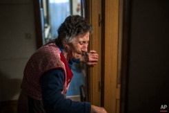 Carmen Martinez Ayuso, 85-years old, cries during her eviction in Madrid, Spain, Friday, Nov. 21, 2014. Carmen Martinez Ayuso lost her foreclosed apartment to a moneylender after she could not afford to pay her debt and the high interest rates due to her financial situation after his son lost his job. Martinez Ayuso got evicted in spite of housing right activists clash with the dozens of riot police and at least one protestor was arrested. (AP Photo/Andres Kudacki)