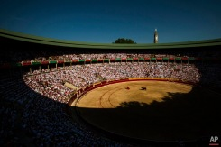 Bullfighter Clemente prays together with a member of his team before they perform during a bullfight at Las Ventas bullring in Madrid, Spain, Friday, May 1, 2015. Bullfighting is a traditional spectacle in Spain and the season runs from March to October.