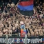 CSKA Moscow fans, most of them without their shirts on, cheer for their team in freezing temperatures, during the Champions League Group B soccer match between CSKA Moscow and Manchester United at the Arena Khimki stadium in Moscow, Russia, on Wednesday, Oct. 21, 2015. (AP Photo/Pavel Golovkin)