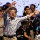 Top opposition presidential candidate Mauricio Macri dances and sings after speaking to supporters in Buenos Aires, Argentina, Sunday, Oct. 25, 2015. Opposition leaders claimed Sunday night that Macri had gotten enough votes in Argentina's presidential election to force a runoff against the ruling party presidential candidate, Buenos Aires Gov. Daniel Scioli. (AP Photo/Victor R. Caivano)
