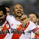 Carlos Andres Sanchez of Argentina's River Plate, right, celebrates with teammate Leonardo Pisculichi after scoring against Brazil's Chapecoense during a Copa Sudamericana soccer match in Chapeco, Brazil, Wednesday, Oct. 28, 2015. (AP Photo/Andre Penner)