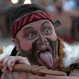 A Maori from the New Zealand performs during the ceremony of the sacred fire of the World Indigenous Games, in Palmas, Brazil, Thursday, Oct. 22, 2015. Billed as the indigenous Olympics, the games are expected to attract nearly 2,000 athletes from dozens of Brazilian ethnicities, as well as from such far-flung nations as Ethiopia and New Zealand. (AP Photo/Eraldo Peres)