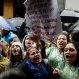High school students shout slogans demanding a better education budget and the resignation of the education minister, outside the Ministry of Education and Culture, in Asuncion, Paraguay, Friday, Oct. 9, 2015. (AP Photo/Jorge Saenz)