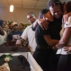 Kansas City Royals player Edinson Volquez, third from Right, embraces his sister Wendy Volquez, left, and mother Ana Ramirez as they stand next to the body of his father during his wake at a funeral home in Santo Domingo, Dominican Republic, Wednesday, Oct. 28, 2015. Volquez played Game 1 of the World Series on Tuesday night, just hours after his father died of heart failure in the Dominican Republic. The elder Volquez, a mechanic, introduced his son to the game when he was about 10 years old. (AP Photo/Tatiana Fernandez)