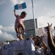 A supporter holds up a baby as he waits for a Jimmy Morales, the National Front of Convergence party presidential candidate, during a campaign rally in Guatemala City, Thursday, Oct. 22, 2015. In Sunday's presidential runoff, Morales, who boasted of his outsider status on the campaign trail, faced Sandra Torres, a businesswoman and longtime political party operative who in a previous campaign divorced former President Alvaro Colom to try to get around a rule barring presidential relatives from seeking the office. Morales won the vote. (AP Photo/Luis Soto)
