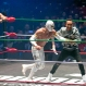 2015 Formula One champion Lewis Hamilton, from Great Britain, pretends to fight with famous Mexican Lucha Libre wrestler Mistico during a promotional event in Mexico City, Wednesday, Oct. 28, 2015. Mexico will hold its first Formula One race in 23 years on Sunday at the Hermanos Rodrigues racetrack. (AP Photo/Eduardo Verdugo)