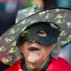 """A woman from a senior citizens' social group coined """"Golden Age"""" wears a costume to commemorate Day of the Dead in the Coyoacan neighborhood of Mexico City, Saturday, Oct. 31 2015. Residents celebrate Day of the Dead to honor the deceased, a tradition which coincides with All Saints Day and All Souls Day celebrated on Nov. 1 and 2. (AP Photo/Esteban Felix)"""