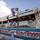 Supporters of Haiti's former President Jean-Bertrand Aristide attend a caravan promoting presidential candidate Maryse Narcisse in Cite Soleil, Port-au-Prince, Haiti, Friday, Oct. 23, 2015. This year's unprecedented three rounds of balloting will pick Haiti's next president, two-thirds of the Senate, the entire Chamber of Deputies and local offices. The Oct. 25 vote is expected to clear the sprawling presidential field for a runoff Dec. 27 between the top two finishers. (AP Photo/Dieu Nalio Chery)