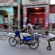 A kid wearing rollerblades hitches a ride via motorbike, in Port-au-Prince, Haiti, Sunday, Oct. 25, 2015. The country held the first-round presidential vote Sunday. Haitians chose between 54 presidential hopefuls and a slew of legislative and municipal candidates. (AP Photo/Ricardo Arduengo)