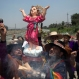 """Shamans hold up a statue of baby Jesus, or """"El Nino"""" in Spanish, as they play drums and maracas during a ritual asking for protection from the natural phenomenon known as El Nino, on the outskirts of Lima, Peru, Thursday, Oct. 1, 2015. Peruvian sailors named the formation El Nino""""the (Christ) Child"""" because it was most noticeable around Christmas. Every few years, the winds shift and the water in the Pacific Ocean gets warmer than usual. That water sloshes back and forth around the equator in the Pacific, interacts with the winds above and then changes weather worldwide. In Peru, they've already declared a pre-emptive emergency to prepare for devastating flooding. (AP Photo/Martin Mejia)"""