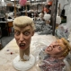 In this Tuesday, Oct. 13, 2015 photo, two versions of latex masks in the likeness of Republican presidential candidate, real estate mogul and reality TV star Donald Trump, sit on a table in the Caretas REV costume maker's plant, in Cuernavaca, Mexico. The company, which ships its costumes to Mexico and the U.S., is gearing up for the Halloween season with two new and very popular products: The Donald Trump mask, and the El Chapo costume, representing the mustachioed, twice-escaped drug kingpin Joaquin Guzman. (AP Photo/Tony Rivera)