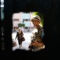 An Egyptian soldier stands guard as a voter leaves a polling station for the runoff to the first round of the parliamentary elections in Giza, just outside of Cairo, Egypt, Tuesday, Oct. 27, 2015. (AP Photo/Amr Nabil)