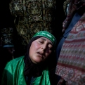 Palestinian Hureyah Masalmeh, 41, the mother of slain of Udai Masalmeh, 24, mourns during her son's funeral at the family house in the West Bank village of Beit Awa, Hebron, Wednesday, Oct. 21, 2015. The 24 year old Palestinian was fatally shot near the village of Beit Awa after lightly injuring an Israeli army officer with a knife, according to a statement from the military. (AP Photo/Nasser Nasser)