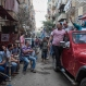 Asmaa Ahmed Abdel Hakeem, an independent candidate, waves from a vehicle as she campaigns in her neighborhood in Giza, Egypt, on Tuesday, Oct. 15, 2015 ahead of Egyptian parliamentary elections. The 40 year-old woman is a manager of a family-owned school. It's her first time to run in elections, and says her family has been supportive of the move. (AP Photo/Eman Helal)