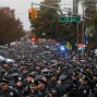 Hundreds of New York police officers gather in the street outside a church for the funeral of Officer Randolph Holder, Wednesday, Oct. 28, 2015, in New York. Holder was killed on Oct. 20 while responding to a report of shots fired and a bicycle stolen at gunpoint in Manhattan's East Harlem neighborhood. (AP Photo/Julie Jacobson)