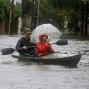 Paul Banker, left, paddles a kayak and his wife Wink Banker, right, takes photos on a flooded street in Charleston, S.C., Saturday, Oct. 3, 2015. A flash flood warning was in effect in parts of South Carolina, where authorities shut down the Charleston peninsula to motorists. (AP Photo/Chuck Burton)